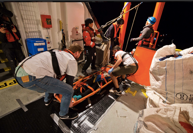 Stretcher transfer on deck copy